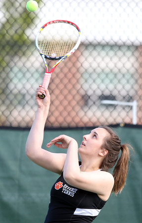DAVID LE/Staff photo. Beverly senior captain Allison Lewandowski serves against Winthrop at third singles on Thursday afternoon. 5/19/16.
