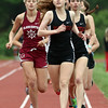 DAVID LE/Staff photo. Marblehead's Lily Gillis and Maura Honan, right, lead the pack in the girls mile while being closely trailed by Gloucester's Eve Feuerbach, left. 5/24/16.