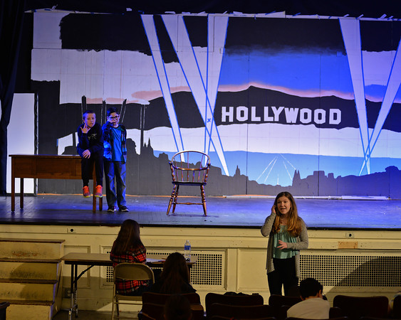 """RYAN HUTTON/Staff photo<br /> From left, Briscoe Middle School students Charlie Barrior, Adam Harrison and Liliana Bauman rehearse """"Lucy Dollar, Private Eye: The Musical"""" on Tuesday afternoon."""