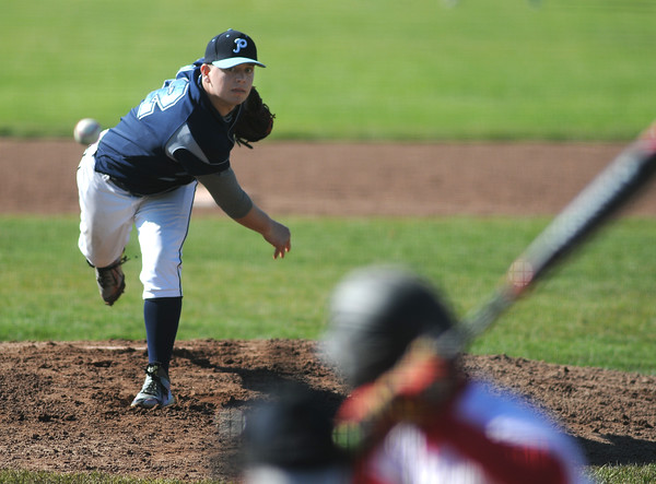 PAUL BILODEAU/Staff photo. Peabody pitcher Jake Zeuli on the mound during Magicians' game against the Tanners at Seaside Park in Marblehead.