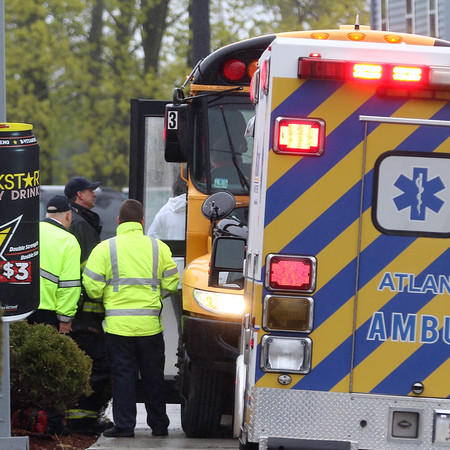 DAVID LE/Staff photo. First responders help students off a school bus following a minor accident at the corner of North and Mason Streets on Thursday afternoon. 5/5/16.