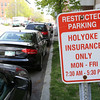 KEN YUSZKUS/Staff photo.   Restricted parking, Holyoke Insurance only, Mon - Fri, 7:30 - 5:30, the sign reads on Norman Street in Salem.     05/16/16