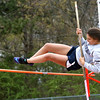 KEN YUSZKUS/Staff photo.    Hamilton-Wenham's Jazmine Kendrick makes it over the bar at the track meet at Ipswich High School.     05/04/16