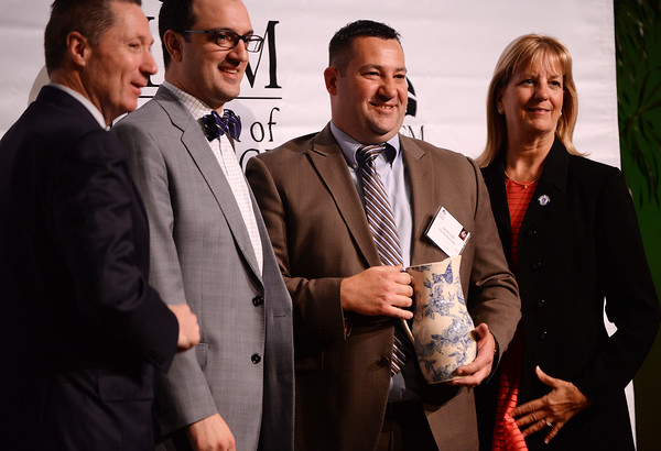 PAUL BILODEAU/Staff photo.  The Community Service Award winner, 3rd from left, James Lister of the Plummer Home for Boys, with, from left, State Rep. Paul Tucker, Chamber President Jason Consalvo and State Sen. Joan Lovely, during the annual Salem Chamber of Commerce's Celebrate Salem Awards Dinner held at the Peabody Essex Museum in Salem.