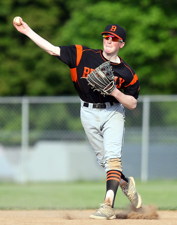 DAVID LE/Staff photo. Beverly shortstop Ryan Collins fires across the diamond to gun down a Danvers runner. 5/27/16.