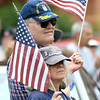 DAVID LE/Staff photo. Bruce and Barbara Dyas, of Beverly, happily enjoy the sights and sounds of the annual Memorial Day Parade down Cabot Street in Beverly on Monday afternoon. 5/30/16.