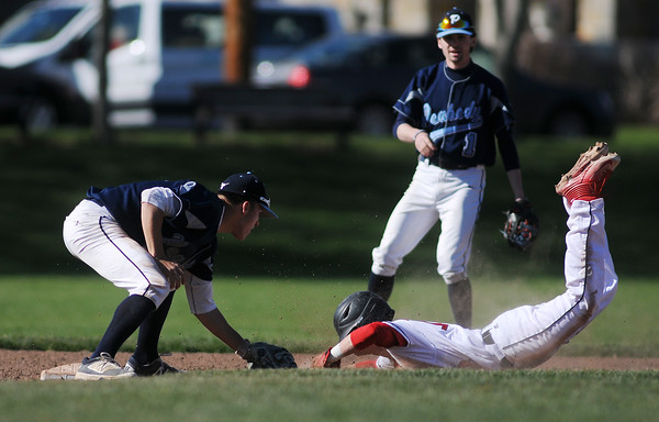 PAUL BILODEAU/Staff photo. Peabody Shortstop Jake Gustin tags out Marblehead's Tim Kalinowski during Magicians' game against the Tanners at Seaside Park in Marblehead.