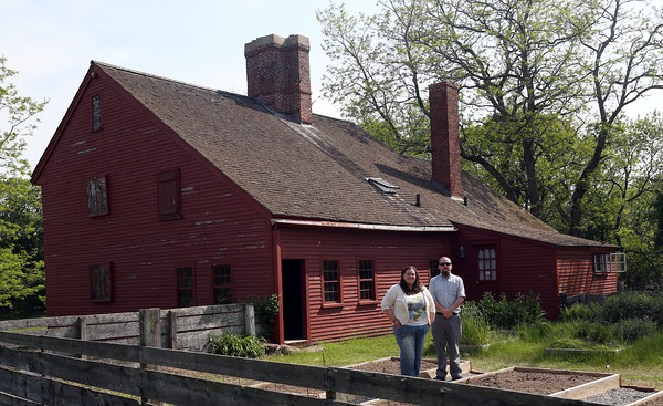 DAVID LE/Staff photo. Candice Dawes, resident caretaker of the Rebecca Nurse Homestead in Danvers, and Jackson Tingle, stand outside the old home. They are putting together a fundraiser to repair the roof of the old building. 5/27/16.