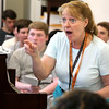 KEN YUSZKUS/Staff photo.    Beverly High School choral director Carolyn Pilanen-Kudlik works with the students during a reheasal for their Thursday concert. The chorus along with the band, will be performing the school song, which is celebrating its 65th anniversary.      05/25/16