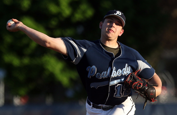 DAVID LE/Staff photo. Peabody starting pitcher Jake Zeuli fires a pitch against NEC rival Danvers on Wednesday evening at Twi Field in Danvers.5/18/16.