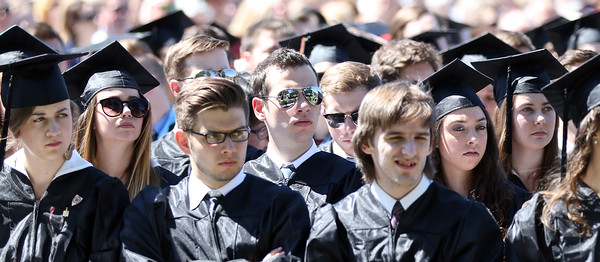 DAVID LE/Staff photo. Gordon College graduates listen to President Michael Lindsay speak at Commencement on Saturday morning. 5/14/16.