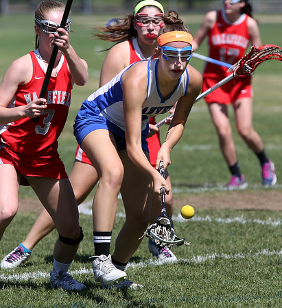 KEN YUSZKUS/Staff photo.          Danvers' Allie Zunick scoops up a loose ball during the Wakefield at Danvers girls lacrosse tournament game.            05/31/16