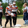 DAVID LE/Staff photo. Beverly senior captains Caitlin Munzing, Olivia George, and Ally Cabral place a bouquet of flowers on first base in memory of Courtney Corning at the annual tournament held at Endicott College. 5/29/16.