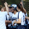 DAVID LE/Staff photo. Peabody's Alyssa Alperen gets high fives from her teammates after launching a home run against Beverly. 5/25/16.