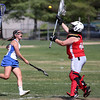 KEN YUSZKUS/Staff photo.          Danvers' Isabel McKenna shoots, but the Wakefield goalie Mikayla White blocks it during the Wakefield at Danvers girls lacrosse tournament game.            05/31/16
