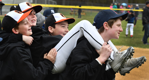 Usually you get carried off the field at the END of a winning season, but practicing on opening day are (l-r) Jackson Sumner, Connor Francesconi (being carried) Connor Donahue and Thomas Keene. <br /> <br /> Photo by joebrownphotos.com