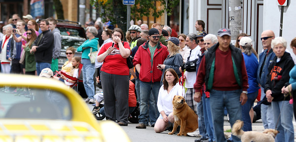 DAVID LE/Staff photo. Despite rain earlier in the day, hundreds of people lined Cabot Street in Beverly to cheer on and watch the annual Memorial Day Parade. 5/30/16.