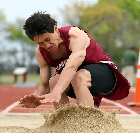 DAVID LE/Staff photo. Gloucester junior Jacob Belcher braces himself as he hits the sand in the pit during the long jump finals at the NEC Conference Meet. 5/21/16.