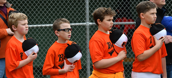 With their hats over their hearts as the National ANthem is sung are Beverly LL Orioles players ( l-r) Ian Paddock, Mason Carter (who also recited the Little League Pledge), Drew Sadoski, and Mason Irwin.<br /> <br /> Photo by joebrownphotos.com