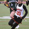 KEN YUSZKUS/Staff photo.      Beverly's Amanda Rosenberger carries the ball while escaping Pentucket players during the Pentucket at Beverly girls lacrosse.          05/02/16