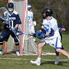 KEN YUSZKUS/Staff photo.     Danvers' Matt McCarthy goes for the net and gets it in during the Peabody at Danvers boys lacrosse game.     04/28/16