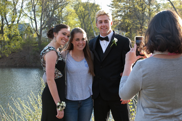 Photo/Reba Saldanha  (from left) Lauren Tianan, Julia Boudreau, and Dean Borders pose for a photo at the library's Rotary Pavilion before boarding buses to the Danvers High School junior prom Friday April 29, 2016