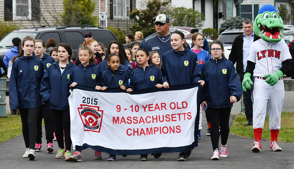 Leading the parade onto the field are the 9-10 year old softball team, who were crowned 2015 State Champions. They were also honored by the State Rep Thomas Walsh and Seantor Joan Lovely during the ceremony. With the chamoions is North SHore Navigators Mascot Chomps (r).<br /> <br /> Photo by joebrownphotos.com