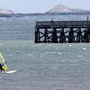 KEN YUSZKUS/Staff photo.   Taking advantage of the windy Monday, Dave Winslow windsurfs in Salem Harbor.     05/16/16