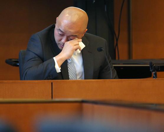 KEN YUSZKUS/Staff photo.      Edwin Woo, son of the murdered Ipswich restaurant owner, gives his impact statement at Salem Superior Court.    05/19/16
