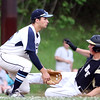 DAVID LE/Staff photo. Bishop Fenwick senior Simon Gonzalez slides safely into third as Peabody junior Chris Gillen waits for the throw as Gonzalez advanced to third on an errant throw to second on a steal attempt. 5/30/16.