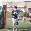 HADLEY GREEN/ Staff photo<br /> Hamilton-Wenham's goalie Mayo Amorello (9) passes the ball at the Beverly v. Hamilton-Wenham boys varsity lacrosse game at Beverly High School. 5/16/17