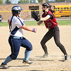 HADLEY GREEN/ Staff photo<br /> Gloucester's Diane Story (13) runs to tag Peabody's Kaitlin Thibodeau-Corey (18) as she runs to first base during the Peabody v. Gloucester girls softball game at the Kiley School field in Peabody. 5/17/17