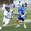 HADLEY GREEN/ Staff photo<br /> Peabody's Nick Patturelli (11) runs up the field while Danvers' Andrew Brennan (25) guards him at the Peabody v. Danvers boys varsity lacrosse game at Peabody Memorial High School. 5/6/17