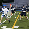 HADLEY GREEN/ Staff photo<br /> Danvers' Brendan Treacy (3) runs with the ball while Swampscott plays defense in behind him at the Danvers v. Swampscott boys varsity lacrosse game at Danvers High School. 5/19/17