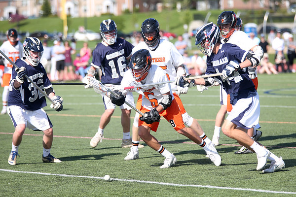 HADLEY GREEN/ Staff photo<br /> Beverly's Sam Abate (5) dives for the ball while Hamilton-Wenham's Zane Clark (32), Gordon Bahr (16), and Clint Gourdeau (44) play defense at the Beverly v. Hamilton-Wenham boys varsity lacrosse game at Beverly High School. 5/16/17