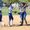 HADLEY GREEN/ Staff photo<br /> Danvers infield players high-five each other before going to their positions at the Danvers v. Lynn Classical High School girls softball game at the Great Oak School in Danvers. 5/10/17