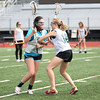 HADLEY GREEN/ Staff photo<br /> Gabby Scibilia faces off with teammate Erin Hennigan at the Essex Tech girls lacrosse practice at Essex Technical High School in Danvers. 5/24/17