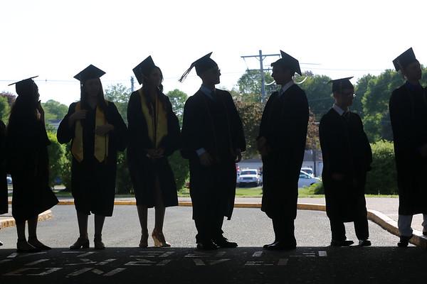 HADLEY GREEN/ Staff photo<br /> Students line up before entering the Bishop Fenwick High School graduation ceremony. 5/19/17