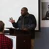 HADLEY GREEN/ Staff photo<br /> Claude Kaitare, a Rwandan genocide survivor and Lynn resident, speaks to Essex Tech students taking a class on genocide, human rights and refugees. A photo of Abraham Lincoln hangs on the library wall in the background. 5/12/17