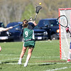 HADLEY GREEN/ Staff photo<br /> Manchester Essex's Bennett Dolan (9) shoots while Masco's (25) and goalie Leah Bennett (17) play defense at the Masco v. Manchester Essex girls varsity lacrosse game held at Masconomet High School. 5/12/17