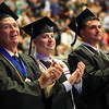 HADLEY GREEN/ Staff photo<br /> Roger Ennis, Timmy Norton, and Nicholas Putnam, all graduates in fire science, clap during Salem State University's commencement for the College of Health and Human Services and Bertolon School of Business. 5/20/17