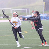 HADLEY GREEN/ Staff photo<br /> Bishop Fenwick's Maddy Bethune (4) runs up the field while Ipswich's Grace Evans (5) plays defense at the Bishop Fenwick v. Ipswich lacrosse game at Bishop Fenwick High. 5/5/17