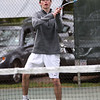 HADLEY GREEN/ Staff photo<br /> Hamilton-Wenham's Ben Danforth returns the ball during doubles play at the Hamilton-Wenham v. Ipswich boys variety tennis match at Pingree park in Wenham. 5/11/17