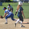 HADLEY GREEN/ Staff photo<br /> Danvers' first baseman Krista Kennedy (14) fields the ball while Essex Tech's (32) Hefter Murphy runs to first base during the Danvers v. Essex Tech girls softball game at the Great Oak School in Danvers. 5/18/17