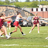 HADLEY GREEN/ Staff photo<br /> Masconomet's Kaitlyn Waystack (7) shoots while surrounded by Newburyport defenders at the Masconomet v. Newburyport girls varsity lacrosse game at Masconomet High. 5/23/17
