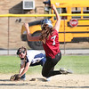 HADLEY GREEN/ Staff photo<br /> Gloucester's Lizzie Schuster (7) slides into second base as Peabody's Makayla Iannalfo (3) fields the fall at the Peabody v. Gloucester girls softball game at the Kiley School field in Peabody. 5/17/17