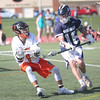 HADLEY GREEN/ Staff photo<br /> Beverly's Nick DiLuiso (1) dodges Hamilton-Wenham defender Gordon Bahr (16) during the Beverly v. Hamilton-Wenham boys varsity lacrosse game at Beverly High School. 5/16/17