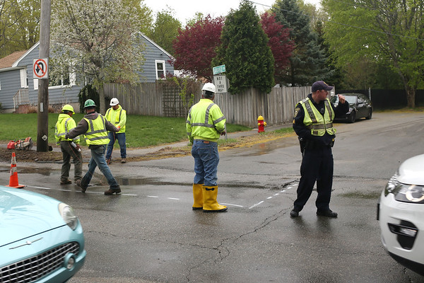 HADLEY GREEN/ Staff photo<br /> Work crews asses the site of a water main break on Lowell Street in Peabody on May 1st, 2017.