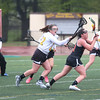 HADLEY GREEN/ Staff photo<br /> Ipswich's Annie Gillis (11) moves the ball while Bishop Fenwick's Alex Butler (22) plays defense at the Bishop Fenwick v. Ipswich lacrosse game at Bishop Fenwick High. 5/5/17