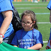 AMY SWEENEY/Staff photo. Lexi Millerick, 7, from Riverside Elementary School in Danvers gets ready to play with the her team in the parachute game. Danvers High School hosted their Annual Special Olympics Danvers Day Games on Friday, May 19, at Danvers High School J. Ellison Morse Athletic Complex at Dr. Deering Stadium. The games are being held for all special needs children in the Danvers Public Schools grades K-12 and surrounding local communities.